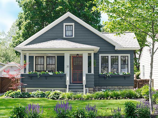 First-time homeowner Bradley Huber hit on a rich palette for the exterior of his 1930 Craftsman after an unfortunate experiment involving pea green. Paint: Behr's Pencil Point (siding), Chocolate Froth (pale trim), Slate Gray (porch floor and ceiling), and Charcoal Black (dark trim).
