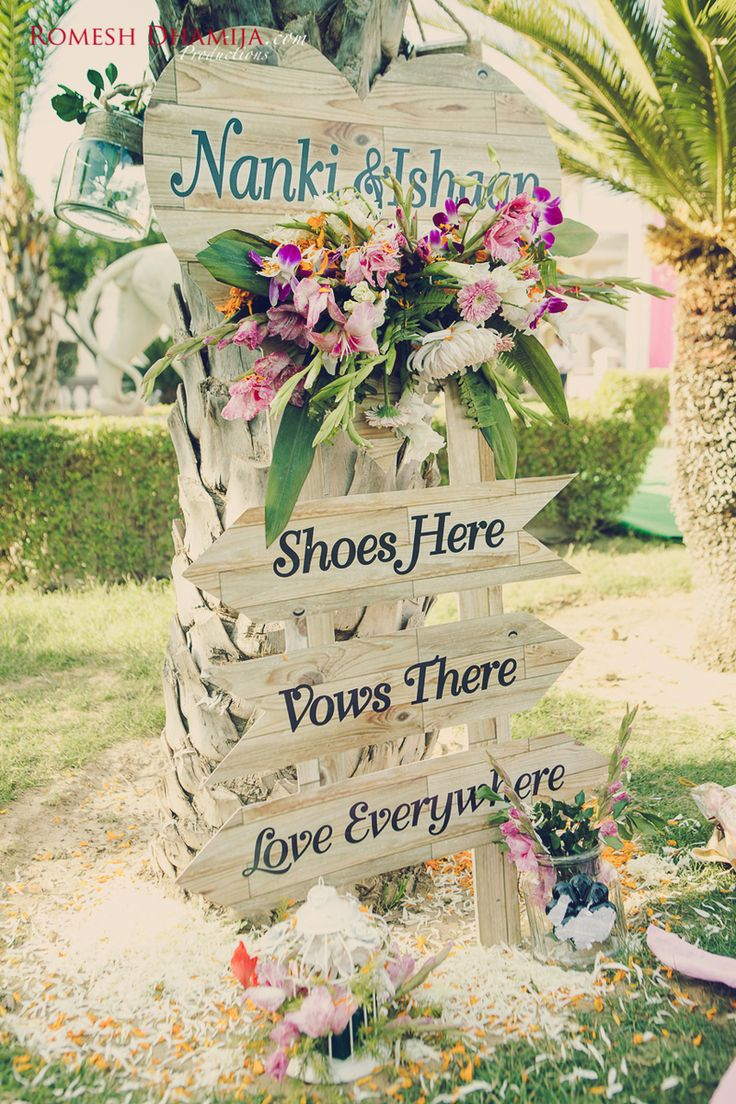 Wedding Quote - Wooden Quote Board | WedMeGood | Cute Wooden Quote Board with Arrows and Flower Decorations Picture Courtesy: @romeshdhamija  #wedmegood #quotes #indianwedding #flowers