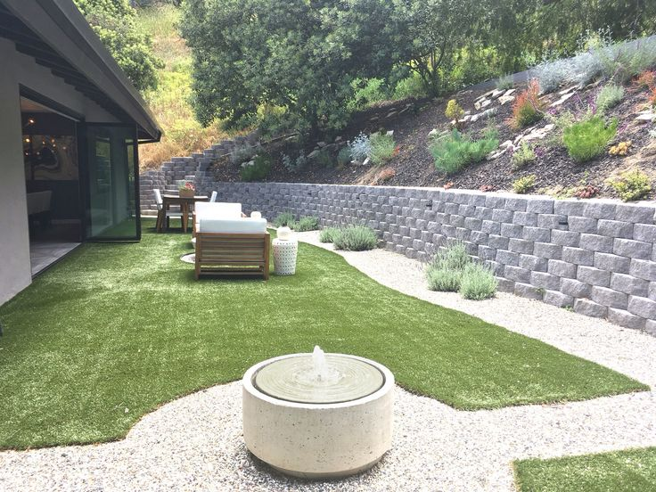 Xeriscaped landscaping  and synthetic lawn keep the yard inviting and maintenance-free.