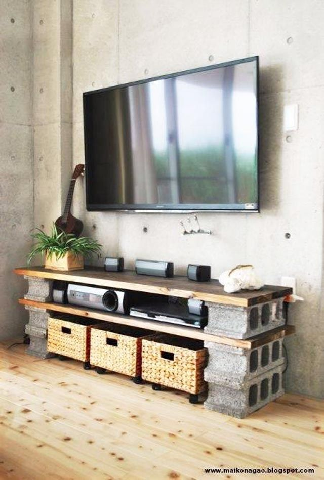 I love this DIY Tv unit I  found on omgfacts.com.  It turned out to be very stylish too.
