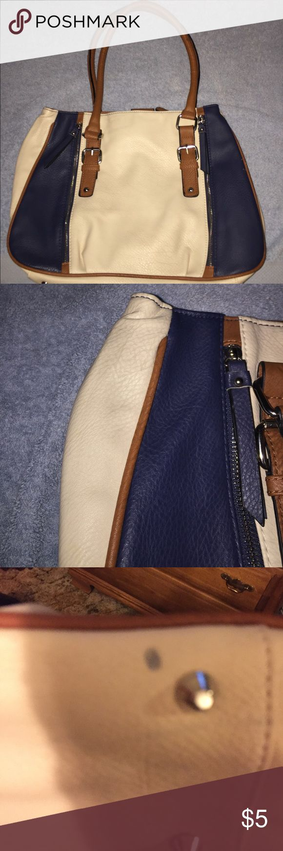 Cream and Navy purse This cute cream and navy purse is showing a little wear on the side (pic 2) and has a spot on the bottom (pic 3) but otherwise is in great shape. Bags Shoulder Bags