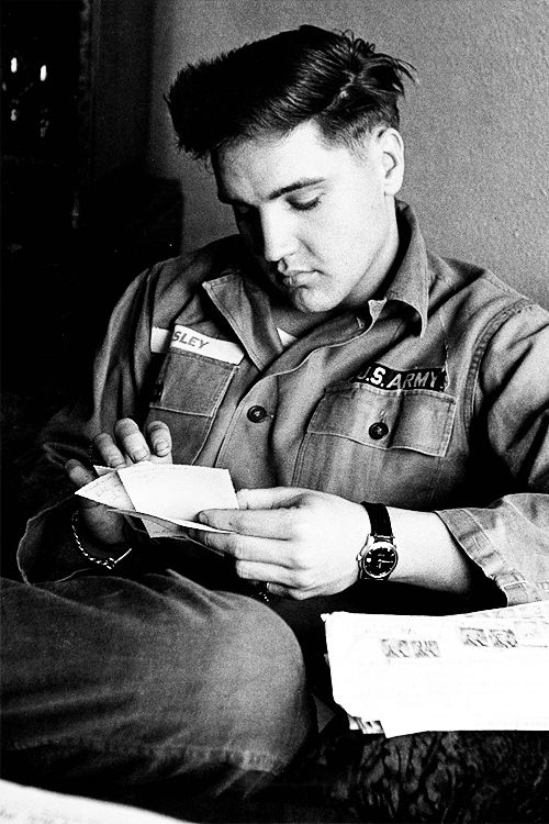 {*Elvis Reading his mail, 1959 while in the Army in Germany*}