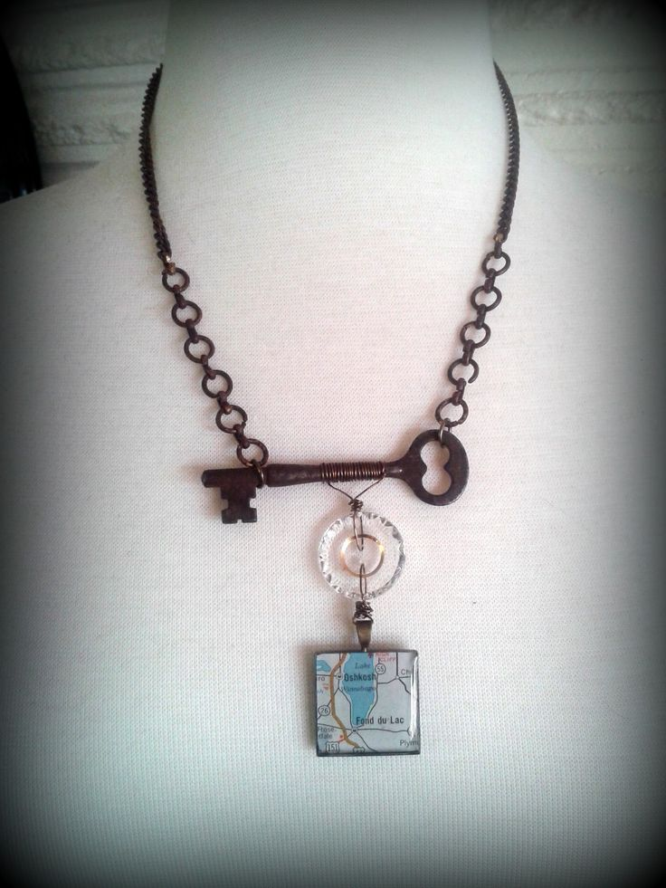 vintage repurposed jewelry Christine Stoll Jewelry: found object jewelry...skeleton key, grandma's button, vintage map under resin pendant, repurposed chain