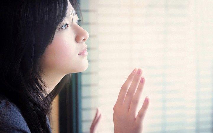 Asian Girl Sad Look Window
