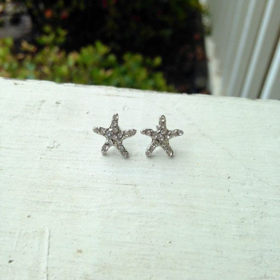 Silver starfish earrings with rhinestone accents