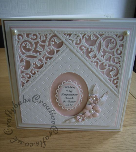 8″ square Wedding card made using included Spellbinders Gold Elements and nesting plain and lacey ovals dies, Memory Box Norrland flower die. Background embossed with Tattered Lace embossing folder.