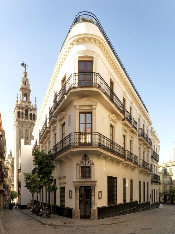 Exterior. EME Fusion Hotel, Seville. Sandra Tarruella Interioristas.  Note the framing of the windows which differs from one story to another. The ironwork is wonderful. I love the shape too; reminds me of a favorite building in Helsinki.