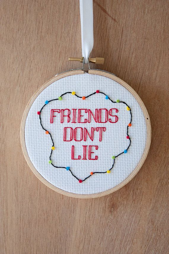 """This """"Friends Don't Lie"""" door hanger. 
