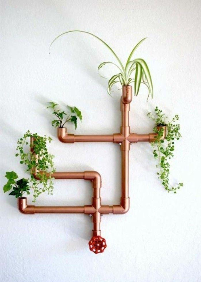 décoration murale très originale, porte plante en tuyau plomberie