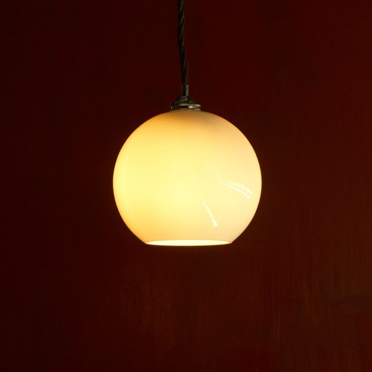 Simple fishbowl pendant in blown glass. Hang in clusters, in straight lines or use as a wall light. Modestly elegant