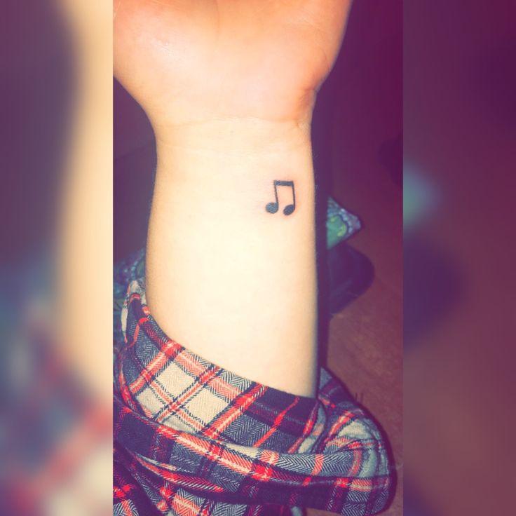 Small Music Note Wrist Tattoo