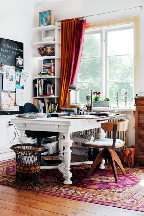 Office/workspace - white desk, oriental rug with pops of fushia/purple, ombre drapes and white walls.