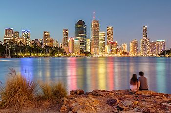 Young lovers take in the view of Brisbane CBD early evening in Queensland. (Copyright belongs to Fred McKie. No rights reserved. Removal of watermark or any unlicensed commercial or editorial usage will be considered a breach of copyright.)