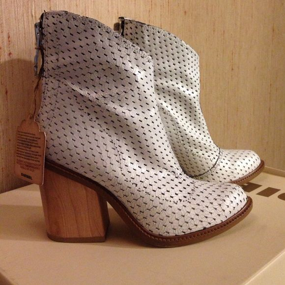 Diesel boots size 6 . White new with tags and box Diesel white boots size 6 . New in box . Dust bag included. Bundle discount offered . Make offer ! Diesel Shoes Ankle Boots & Booties