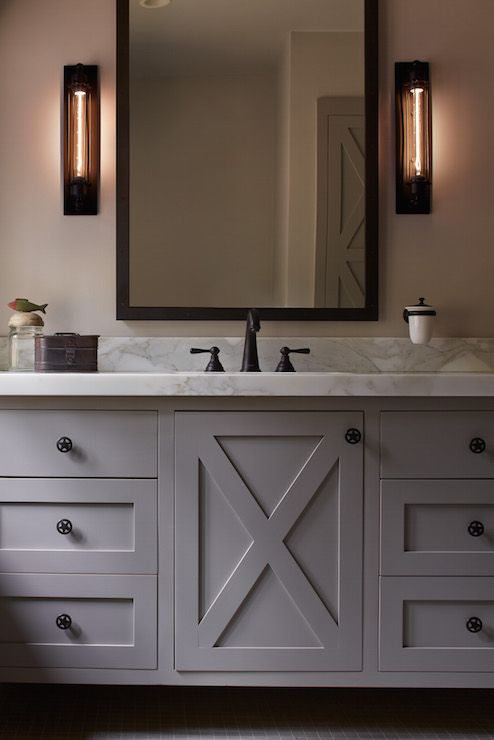 Wonderful Chic Cabin Bathroom Boasts A Gray Washstand Adorned With Gray X Doors  Adorned With Star Knobs