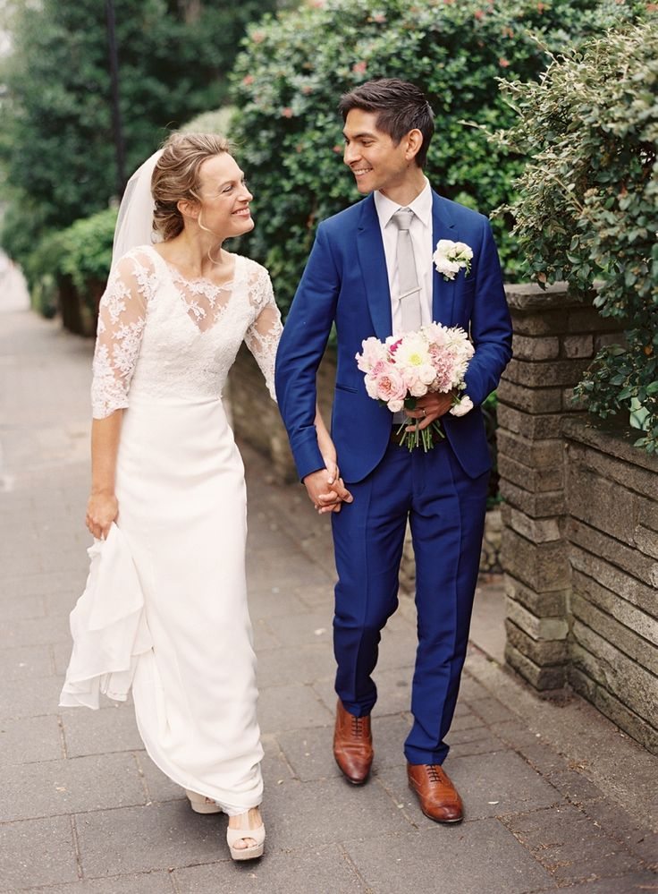 Image By Depict Photography - An Elegant Contemporary Wedding At Loft Studios In West London With Bride In Gown By Louise Selby And Groom In Electric Blue Paul Smith Suit With Giant Light Up Initial Letters From Vowed And Amazed And Red London Buses For Transport And A Pink And White Colour Scheme