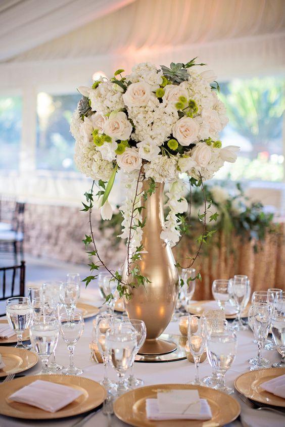 Glamorous gold vase white floral wedding reception centerpiece; Featured Photographer: Nicolette Moku Photography