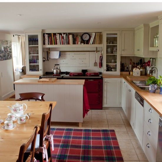 This Shaker-style kitchen features a clever built-in bookcase, perfect for cookery books