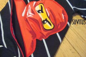 Appliqued red Ninjago shirt with diagonal zipper pocket by Suvitus