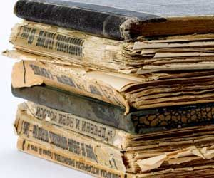 Do you have old books in your collection that hopefully are in better shape than the ones pictured?  Here are cleaning tips to help keep them in top shape.