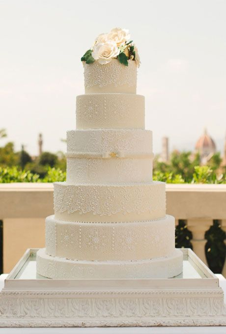 Brides.com: . Each of the six tiers of this wedding confection by Italy-based L'Arte della Torta di Melanie Secciani is covered with a different, intricately detailed lace pattern.
