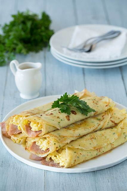 Herb Crepes with Eggs, Swiss, Ham and Browned Butter. A fancy and delicious breakfast or brunch. Either leave out the ham or substitute soy - based Canadian Bacon for a vegetarian meal.