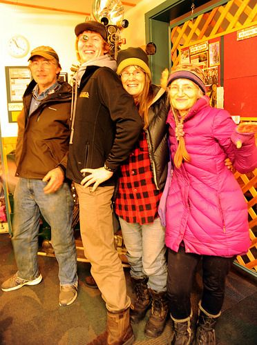 Alaskans: Otto, August (with an eye piece), Charlotte, and Sunrise, Kilcher family, movie camera in back ground, mid-winter, going to see Smaug at the Homer Theatre, Homer, Alaska, USA