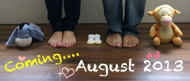 """We are growing by two feet!"" Our first baby announcement!"