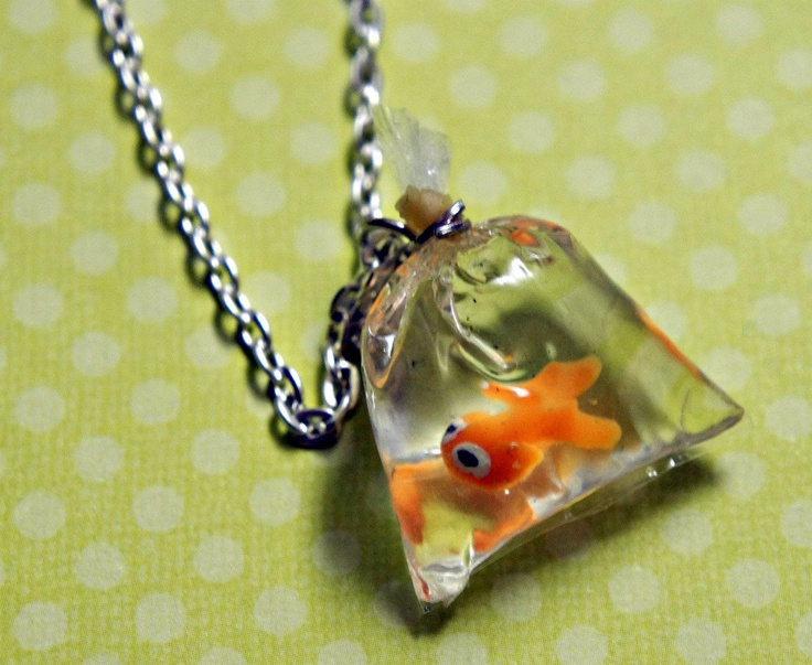 I love this. and i want it. goldfish in a bag necklace. $24.50, via Etsy.
