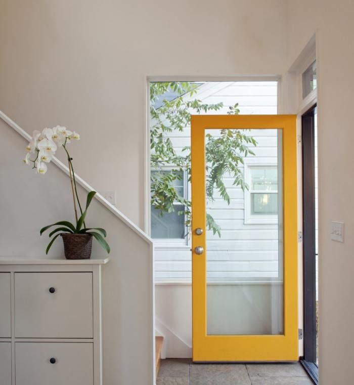 Home Entryway with Yellow Door Frame in Modern House, Remodelista