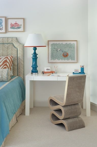 Small workspace blending with turquoise and coral palette. Annsley Interiors