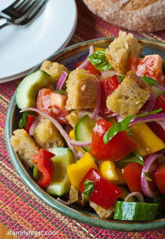 Panzanella (Bread Salad) - My all-time favorite summertime salad! Crispy chunks of bread, fresh tomatoes, bell peppers, cucumbers and the most amazing vinaigrette!
