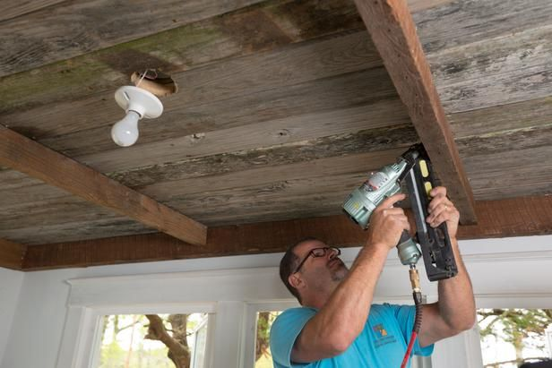 How To Install A Reclaimed Wood Ceiling Treatment: Attach joists to the ceiling with 15 ga. finish nails. If the ceiling treatment is not thick enough to serve as an anchor then select a fastener long enough to penetrate into the plywood layer installed earlier. From DIYnetwork.com