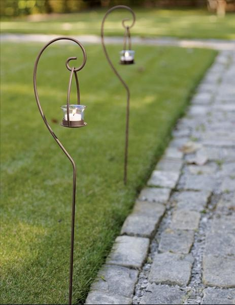 Tealight Garden Stakes - fantastic for that outside summer wedding!  Only $9.60…                                                                                                                                                                                 Más