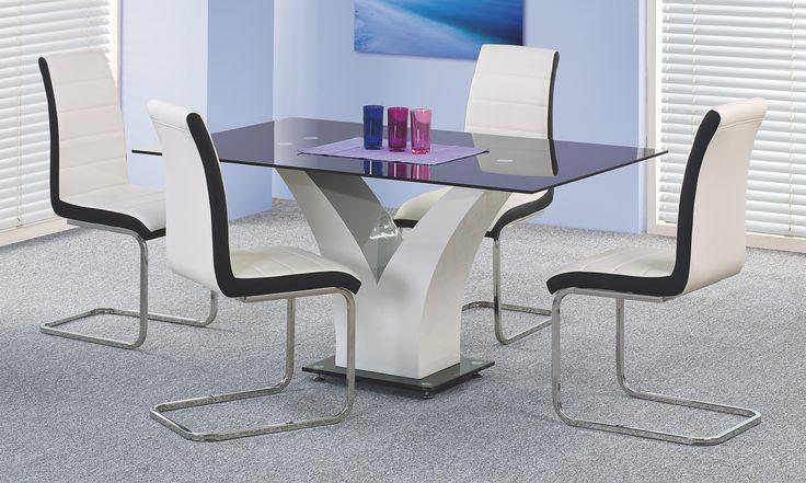 Moderný a luxusný jedálenský stôl Vesper značky Halmar je viac ako vhodný do moderných interiérov Vašej kuchyne, či jedálne. Stôl je vyrobený z kvalitnej lakovanej MDF drevotriesky a vrchná tabuľa je vyrobená z dizajnového čierneho skla. Jedálenský stôl sa dodáva v čierno-bielej farebnej kombinácií a pojme až 6 osôb.
