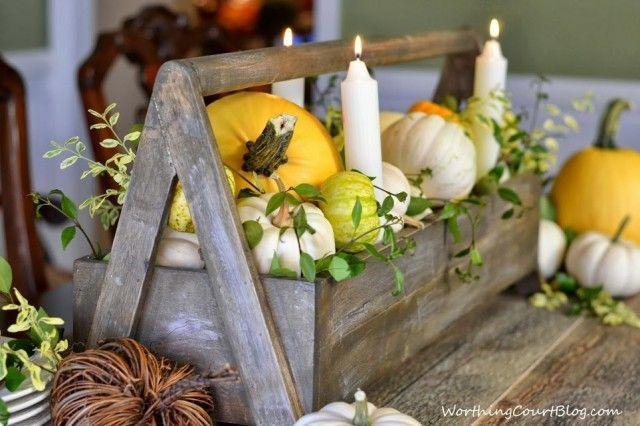 Worthing Court: Wooden tool box filled with yellow and white pumpkins and fresh greenery.  The aged wood makes a great base for the centerpi...