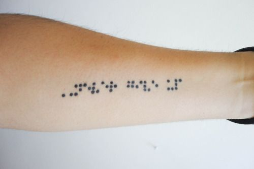 "Means ""Never give up"" in Braille."
