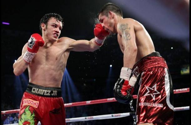 "Julio César Chávez Jr. punches Sergio ""Maravilla"" Martínez."