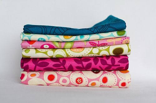 Advice on folding different sizes of fabric so they all look the same (great for organization or photography)
