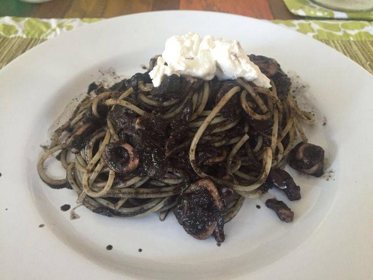Spaghetti al nero di seppia con un tocco di ricotta fresca. Inch's squid spaghetti with a touch of fresh ricotta. Snowy mountain ( monte innevato )