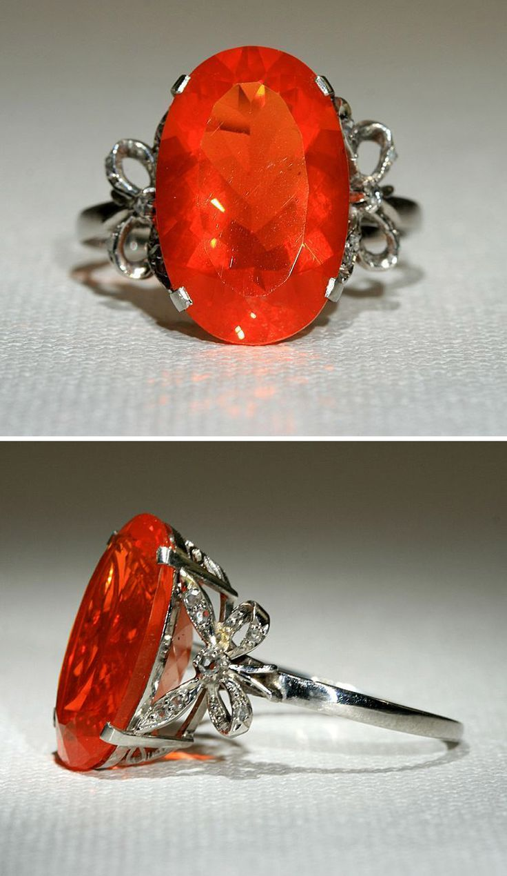 Art Deco Platinum 4.75ct Fire Opal Ring with Diamond Bows. Circa 1930, bows on the side set with rose cut diamonds. http://www.rubylane.com/item/518197-RG0509102V/Art-Deco-Platinum-4-75ct-Fire