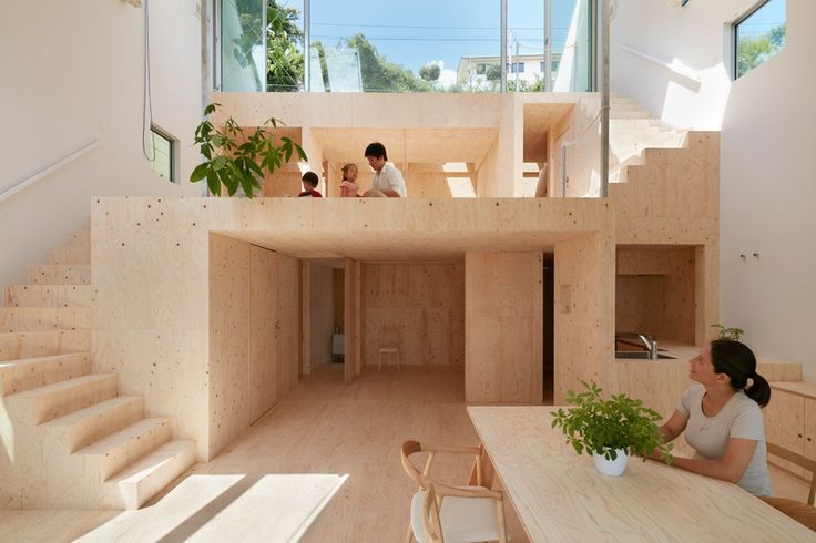Japanese architect Tomohiro Hata gave this ridged metal residence in Kobe a staggered plywood interior