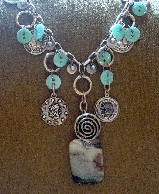 button necklace. Colorful buttons add a nice touch of color to vintage charms or pieces.