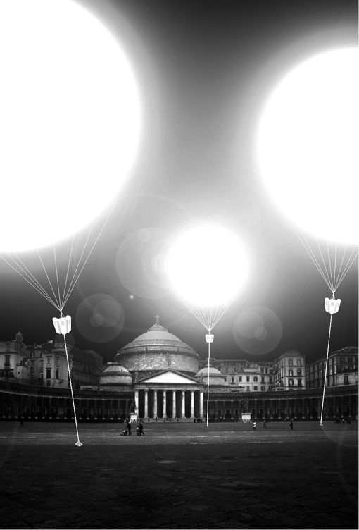 carsten nicolai three large scale balloons swaying in the wind moored with metal cylinders