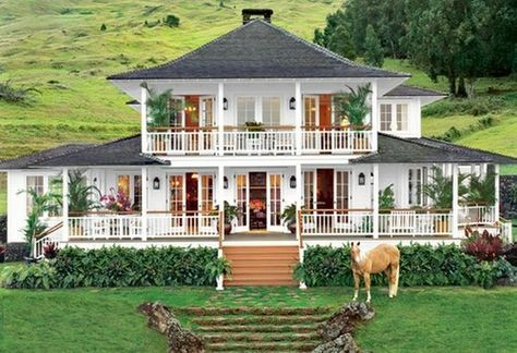 Oprah's beautiful Hawaiian hillside home overlooking the Ocean. Sprawling white plantation style with beautiful porches.