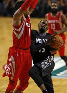 Minnesota Timberwolves' Shabazz Muhammad (15) is fouled by Houston Rockets' Dwight Howard (12) during the first half of an NBA basketball game in Mexico City, Wednesday, Nov. 12, 2014.  (AP Photo/Dario Lopez-Mills)