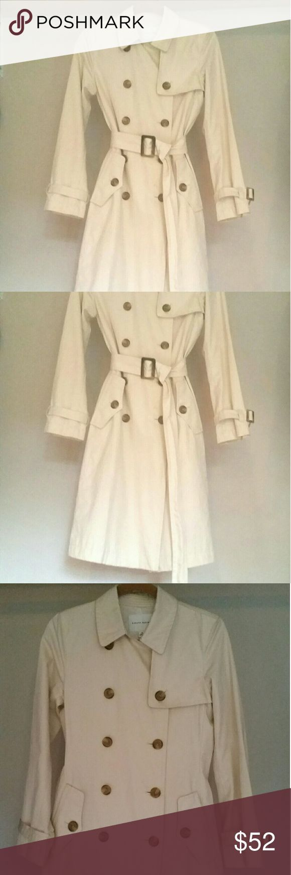 Banana Republic woman's rain/trench coat, size S Thiss is a traditional style Banana Republic woman's rain/trench coat. Size small. Fully lined. Verstatile. Only worn a few times. It is in perfect condition...not a single stain or flaw. No missing buttons. Has a belt for the waist to give it a more feminine, body shaping look. The ends of the sleeves have matching, minature belts to tighten for cold weather.   Please feel free to contact me with questions or if you need exact measurements…
