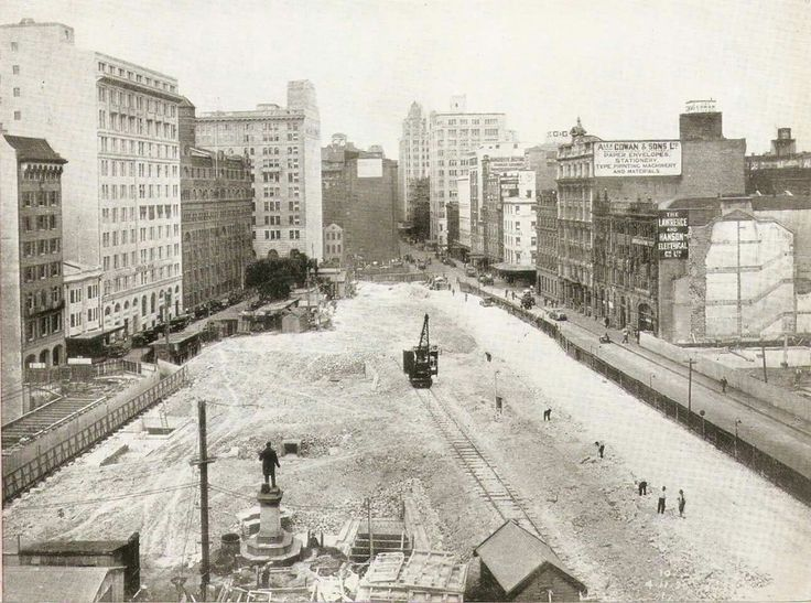 The former Wynyard Square/Park ripped up and used as a works site for the building of the Wynyard Railway Station underground layout. •National Library of Australia•