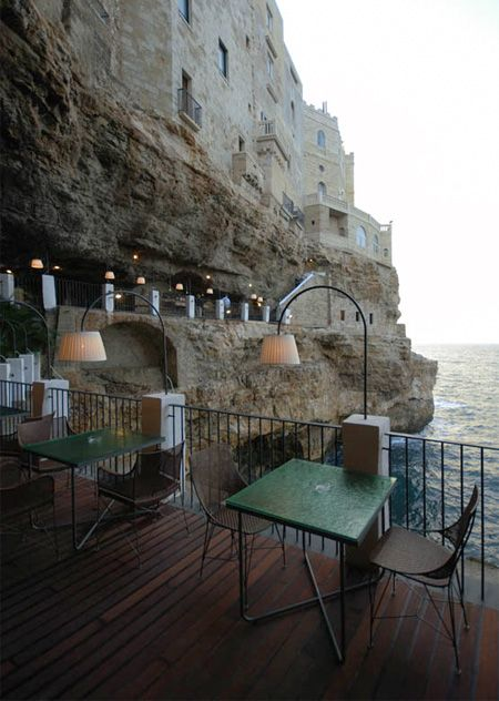 Cave restaurant is located underneath the Grotta Palazzese hotel in a small town of Polignano a Mare, Italy