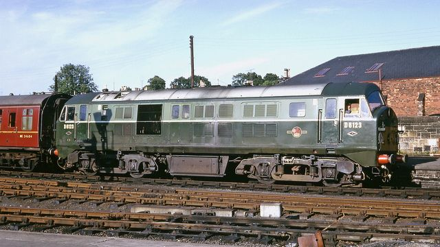 NBL/Paxman Type 2 Class 21 Bo-Bo D6123 at Perth on a Dundee to Glasgow express on 18th July 1966. Built by the North British Locomotive Company, Glasgow and delivered on 22nd Sept 1959. Re-engined with a more powerful engine in 1963 and re-designated Class 29. Withdrawn on 21st Sept 1971. Cut up at Glasgow Works 1971-72.